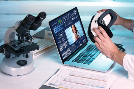 Two doctors who are going to do a collaborative work at a distance/ doctor with Virtual reality equipment in the laboratory