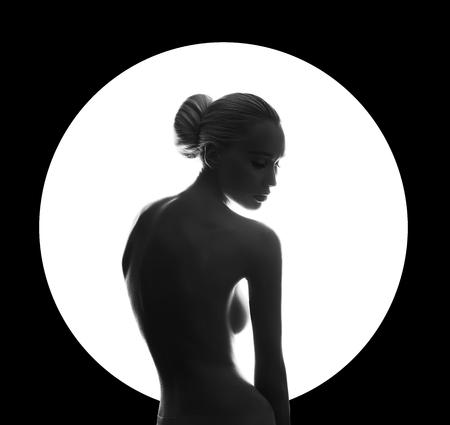 Foto de Art beauty Nude woman on black background in white circle ring. Perfect body, slim figure, beautiful Breasts. Nude fashion woman posing sensual look perfect makeup. Art of erotica - Imagen libre de derechos