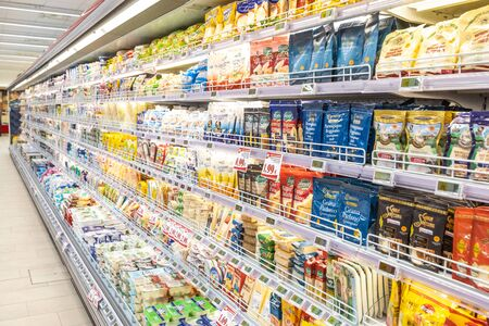 Photo pour Rome / Italy. December 05, 2018: Shelving with products of different nature, variety of food displayed on the shelves inside a MA supermarket in Rome in Italy. Refrigerators with food and dairy products. - image libre de droit
