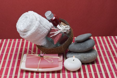 Spa background with hygiene items in red.