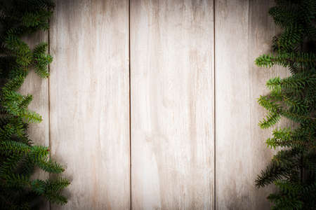 Photo pour Christmas wooden background with candles and a space for text - image libre de droit