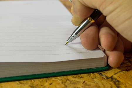 Foto de The human hand with a pen. - Imagen libre de derechos