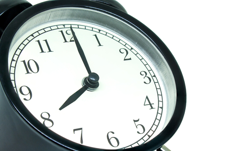 Photo pour Time Management Concept : Side view retro black alarm clock showing eight o'clock isolated on white background. - image libre de droit