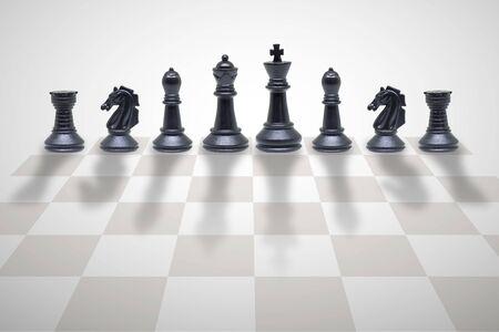 Foto de Business Competition Concept : Wooden chess pieces standing on chess board. - Imagen libre de derechos