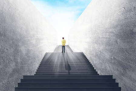 Photo pour Business Vision and Success Concept : Businessman standing on concrete staircase and looking forward to sky. - image libre de droit