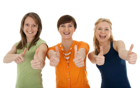 Three happy and energetic young women giving thumbs up.