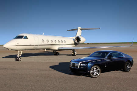 Photo for Stock Photo - SHEREMETYEVO, RUSSIA - APRIL 24 2015: Gulfstream G550 and Rolls Royce Wraith in Sheremetyevo international airport, Russia - Royalty Free Image