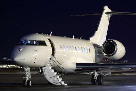 Photo pour Business jet airplane at night. - image libre de droit