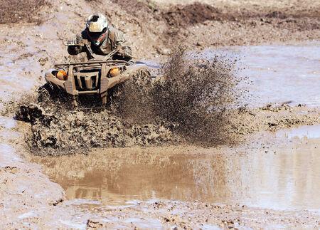 Extreme driving ATV on overcoming terrain.