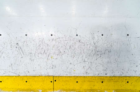 Photo pour Hockey rink boards with scratched and damaged surface - image libre de droit