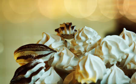 meringue cakes with vanilla and cocoa, toned photo
