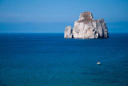 Pan di Zucchero rocks in the sea, in Masua (Nedida), Sardinian coast. Daily time