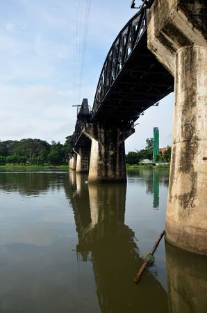 People travel and walking at the Bridge of the River Kwai. Internationally famous, black iron bridge was built from by Japanese supervision by Allied prisoner-of-war labour as part of the Death Railway linking Thailand with Burma in Kanchanaburi, Thailand