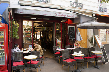 French people and foreigner travelers use service and eat, drink food at restaurant on September 6, 2017 in Paris, France