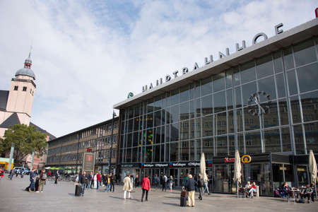 Landscape cityscape and German and foreign travelers walking at front of koln or kolne Central Hauptbahnhof railway station with Basilica of St Ursula Cologne on September 11, 2017 in Cologne, Germany