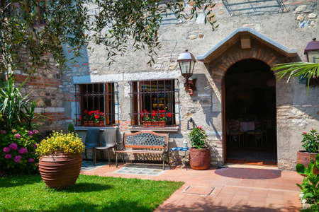 Photo for small patio and entrance to the house in Sirmione, Lake Garda, Italy  - Royalty Free Image