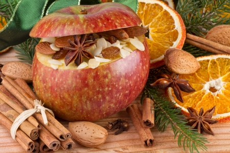 baked apple on wooden background
