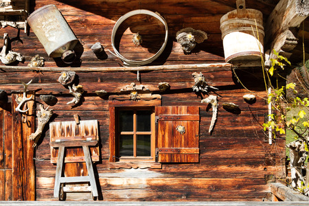 Rural alpine scenery. Retro decoration and architecture details of a alpine hut.