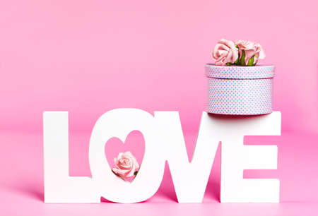 Photo for Word Love and gift box at pink color background - Royalty Free Image