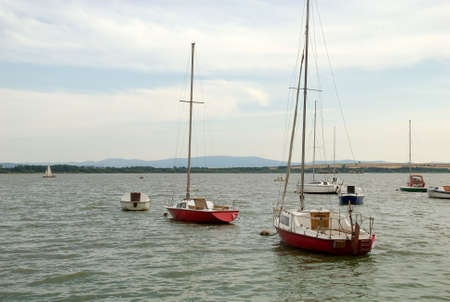 Sailing boats and motorboats moored on the lake