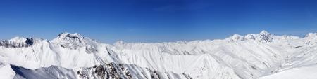 Panorama of snow winter mountains  Caucasus Mountains, Georgia, view from ski resort Gudauri