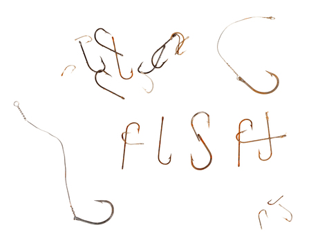 Word F I S H and old rusty fish hooks. Isolated on white background