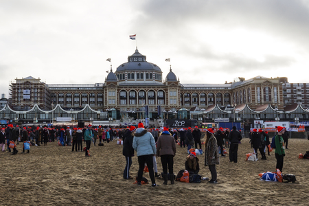 SCHEVENINGEN, 1 January 2018 - Group of participants of the first new year dive dress up back and wait for the others members after being in the frozen North Sea water, The Netherlands