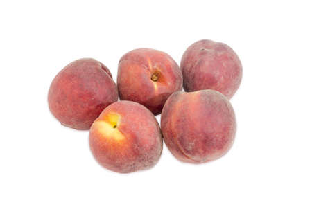Several ripe fresh peaches on a light background