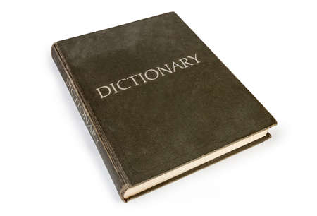 Closed old hardback dictionary with cloth cover on a white background
