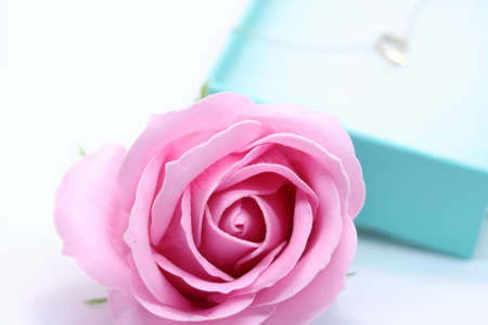 Photo for Heart necklace and pink rose in gift box - Royalty Free Image