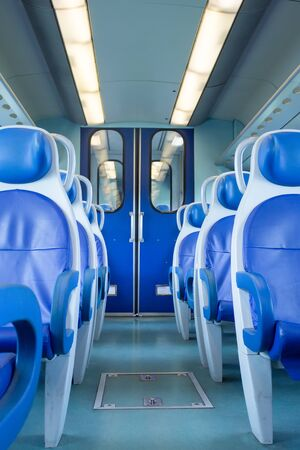 Photo pour Empty interior of the train for long and short distance in Europe, Italy, train carriage with blue seats, vertical orientation - image libre de droit
