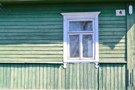 Photo pour Vintage windows jamb of traditional wooden russian house in village, close up with copy space - image libre de droit