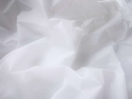 Photo pour Wrinkled white fabric. Close-up photo. Abstract light, white background. - image libre de droit