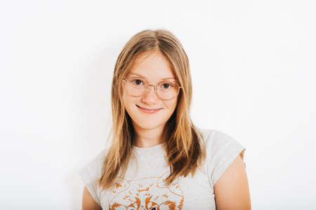 Foto de Studio shot of young preteen 10-12 year old girl wearing round eyeglasses, white background - Imagen libre de derechos
