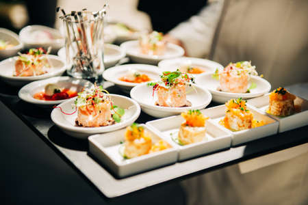 Photo for Salmon tatrare in small plates, catering event, banquet food - Royalty Free Image
