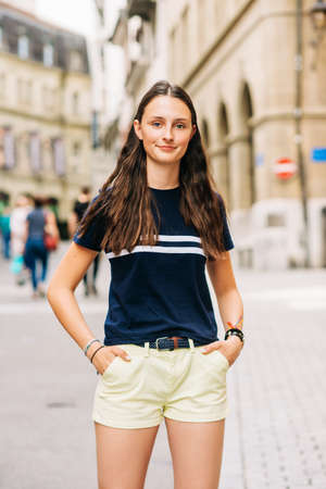 Photo for Outdoor portrait of pretty teenage girl on the city street - Royalty Free Image