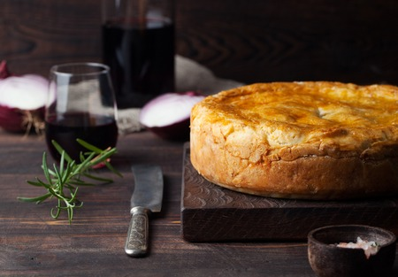 Pot Meat Pie with wine Wooden background Copy space
