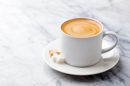 Photo pour Coffee, espresso in white cup of marble table background. Copy space. - image libre de droit