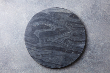 Foto de Black marble texture board on grey background. Top view. Copy space. - Imagen libre de derechos