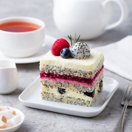 Photo pour Berry, poppy seed layered cake on white plate. - image libre de droit