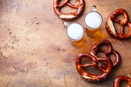 Foto per Beer, salted pretzels, potato chips on wooden background. Top view. Copy space. - Immagine Royalty Free