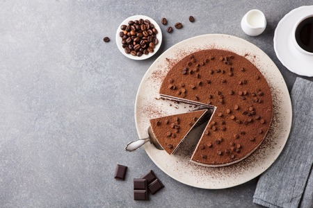 Photo pour Tiramisu cake with chocolate decoration on a plate. - image libre de droit