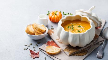 Photo pour Pumpkin and carrot cream soup in bowl on grey stone - image libre de droit