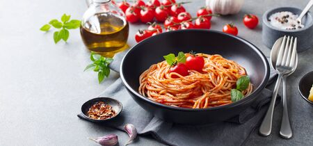 Photo for Pasta, spaghetti with tomato sauce in black bowl on grey background. Copy space. - Royalty Free Image