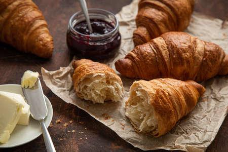 Foto für Freshly baked croissants with berries jam and butter, dark wooden background,  selective focus - Lizenzfreies Bild