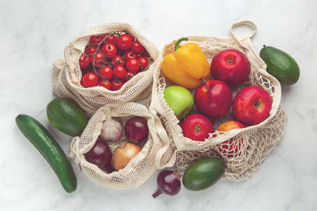 Photo for Zero waste and eco-friendly concept. Fresh organic fruits and vegetables in reusable textile shopping bags. top view, toned - Royalty Free Image