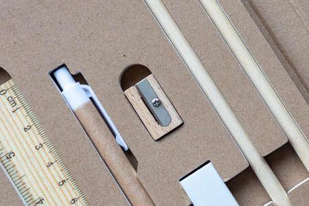 Photo pour Stationery set of eco-friendly materials. Wooden pencil, sharpener, cardboard pen and eraser. - image libre de droit