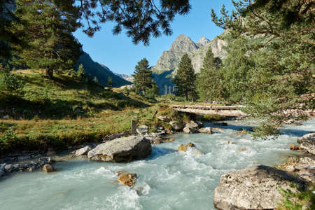 Photo pour Mountain river landscape. Alps. In the morning in clear sunny day on a wide corner. The river quickly flows. Mountaineering and hikes. Amazing. Around. - image libre de droit