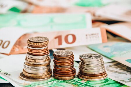 Photo pour Euro coins on banknote money background, a coin on the background of stacks of coins and banknotes - image libre de droit