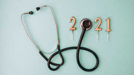 Photo for 2021 year made of gold candles with medical stethoscope. Copy space. New year and Merry christmas medical concept. Healthy lifestyle. Hospital decorations - Royalty Free Image
